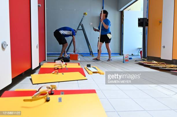 Workers paint the locker room of La conterie public swimming pool in ChartresdeBretagne suburbs of Rennes western France on May 28 2020 Swimming...