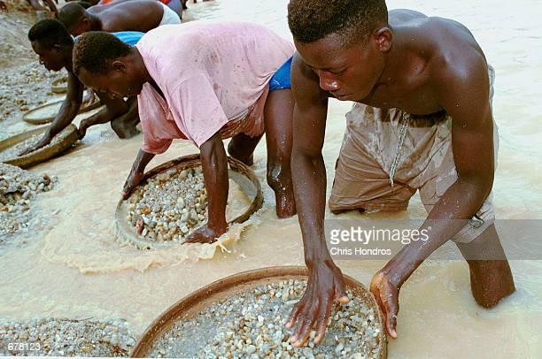 Workers pan for diamonds in a government controlled diamond mine June 15, 2001 near Kenema, Sierra Leone. Muslim militant Osama bin Laden's al Qaeda...