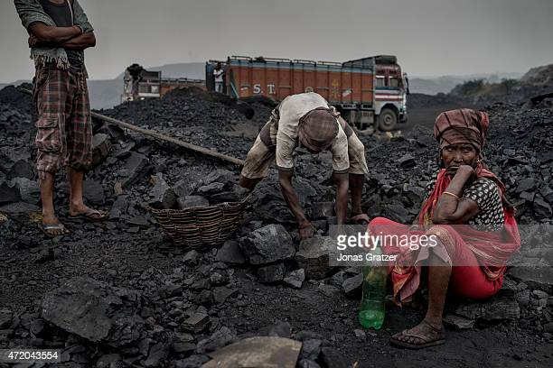 Workers panning through the coal mines in Jharia Jharia in India's eastern Jharkand state is literally in flames This is due to the open cast coal...