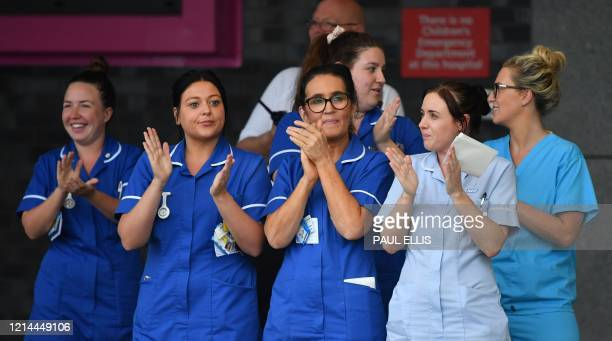 """Workers participate in a national """"clap for carers"""" to show thanks for the work of Britain's NHS workers and other frontline medical staff around the..."""