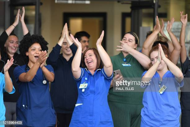 "Workers participate in a national ""clap for carers"" to show thanks for the work of Britain's NHS workers and other frontline medical staff around the..."