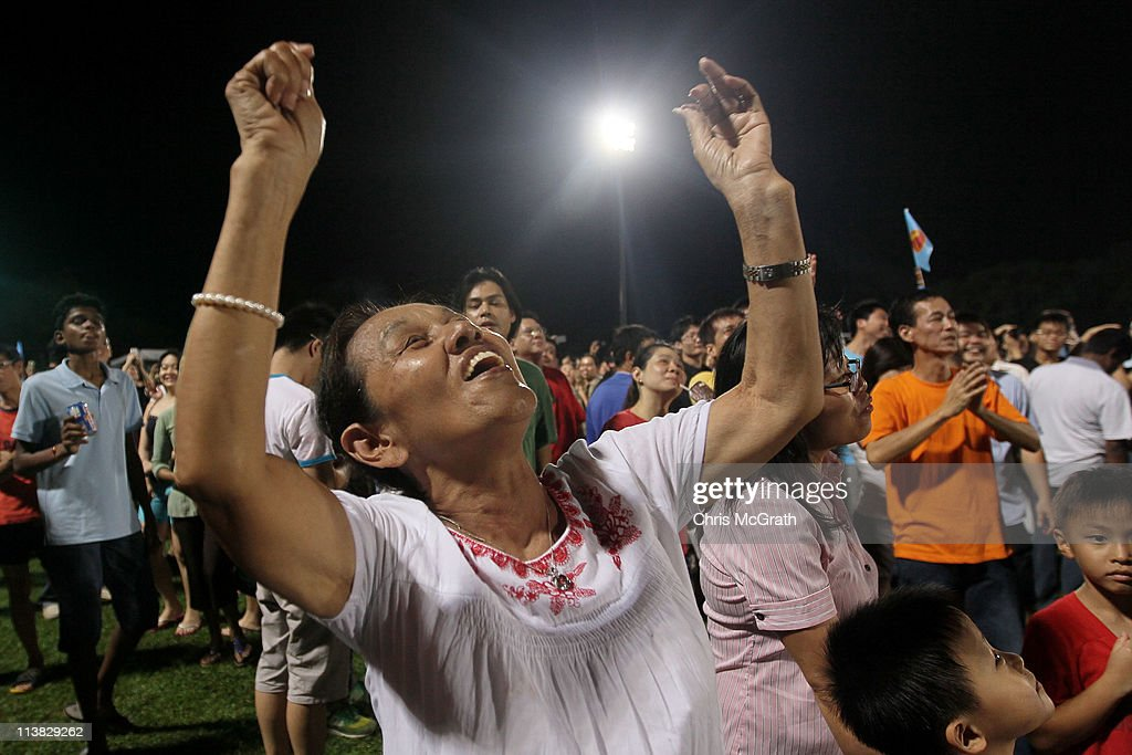 A Workers Party (WP) supporter cheers and dances while waiting for election results at Hougang Stadium on May 7, 2011 in Singapore. Voters turned out in record numbers to take part in the countries 11th elections since independence. The 2011 general election has been the most contested in Singapore's history with 82 seats out of 87 being contested. In 2006 the People's Action Party (PAP) received 66.6 per cent of the vote.