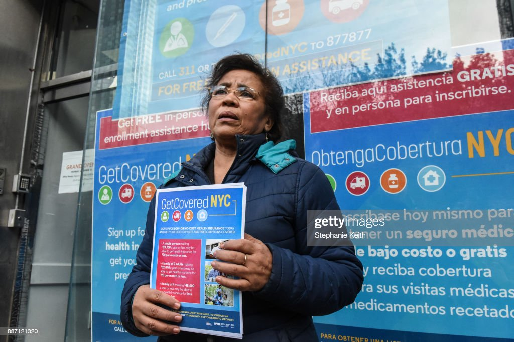 Workers pass out informational flyers in front of a new health care enrollment center on December 6, 2017 in the Queens borough of New York City. GetCoveredNYC is a citywide initiative focused on signing up New Yorkers for health insurance.