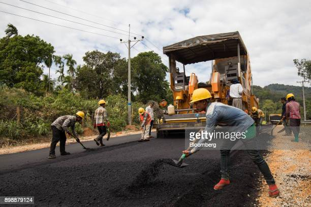 Workers pave a highway under construction on the outskirts of Dawei Myanmar on Friday Dec 22 2017 As the US and Europe grow increasingly outraged...