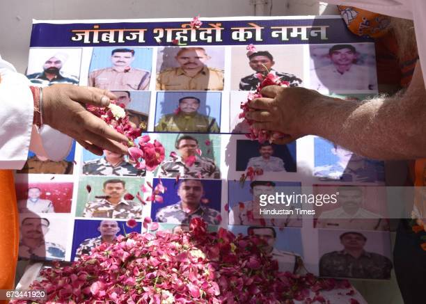 BJP workers paying homage to CRPF martyrs who died in Sukma after MCD results at party office on April 26 2017 in New Delhi India It's a third term...
