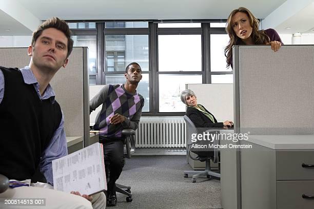 workers peeking from cubicles - großraumbüro stock-fotos und bilder