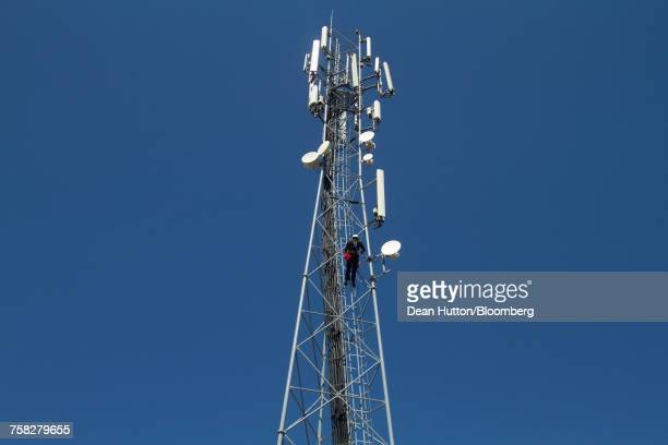 workers perform contract maintenance work on a cellular phone mast - hutton stock photos and pictures