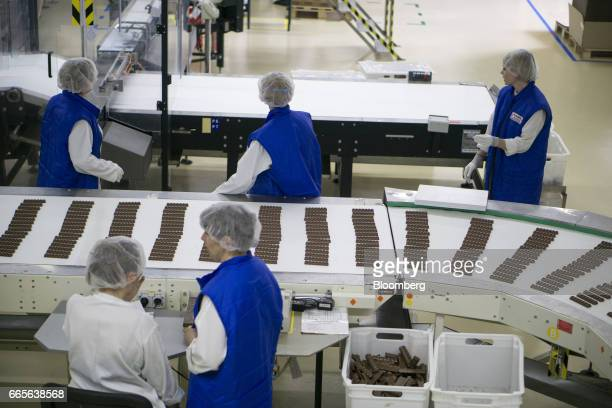 Workers perform quality control checks on Oreo Milka chocolate bars during control checks on the production line at the Trostyanets confectionery...