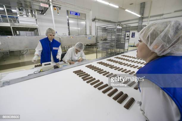 Workers perform quality control checks on Oreo Milka chocolate bars on the production line at the Trostyanets confectionery plant operated by...