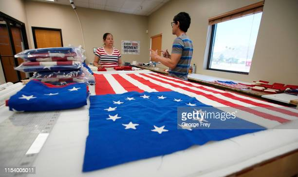 Workers pieces together a new Betsy Ross flag made out of fire proof material at Colonial Flag on July 5, 2019 in Salt Lake City, Utah. The Betsy...