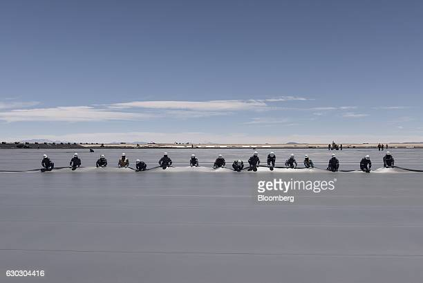 Workers place geomembrane liner on a new industrial pool inside the Salar de Uyuni in Potosi Bolivia on Saturday Dec 10 2016 Bolivia has the largest...