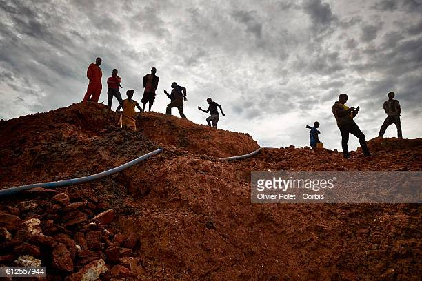 Workers place the hoses to pump out water from the mining pools 28 March 2013 in order to access the diamond carrying rock layer in the 7/7 diamond...