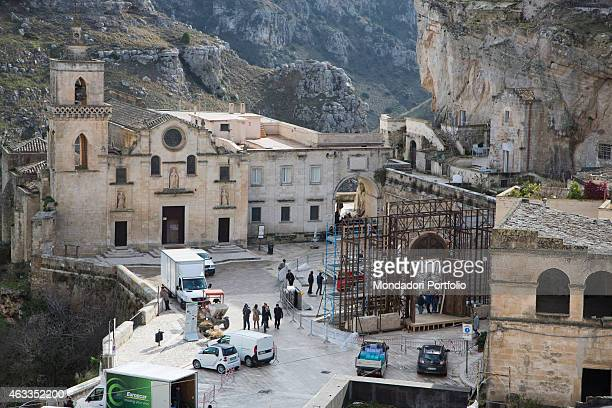 Workers placing a scaffolding beside the church of Saints Peter and Paul on the set of the film Ben Hur being shot in Matera on January 23 2015