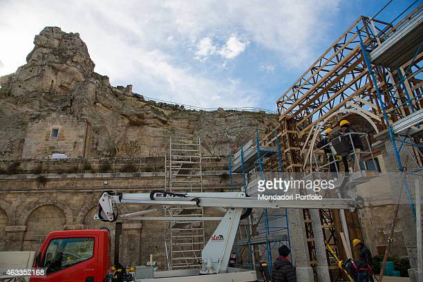 Workers placing a scaffolding beside the church of Santa Maria di Idris on the set of the film Ben Hur being shot in Matera on January 23 2015