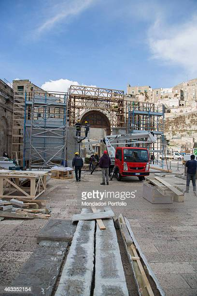 Workers placing a scaffolding on the set of the film Ben Hur being shot in Matera on January 23 2015