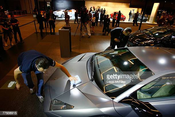 Workers polish the $14 million Lamborghini Reventon during the twoday media preview of the Los Angeles Auto Show first major North American car show...