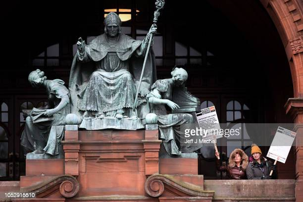 Workers pose for a photograph as they stand on a picket line outside the Kelvingrove Art Gallery and Museum on October 24, 2018 in Glasgow, Scotland....