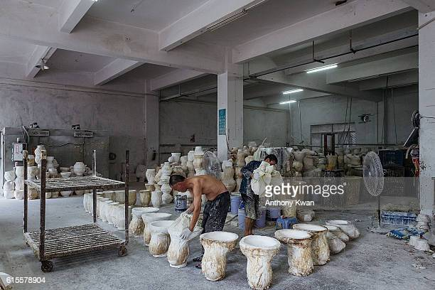 Workers pour liquid latex into molds to make masks of Donald Trump at the Shenzhen Lanbingcai Latex Crafts Factory on October 18 2016 in Shenzhen...