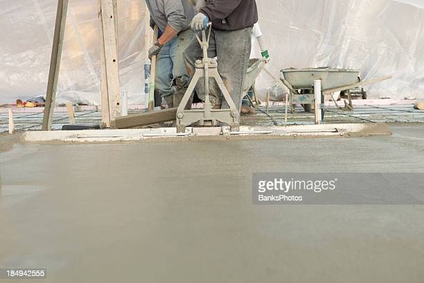 Workers Pouring a Concrete House Foundation Slab
