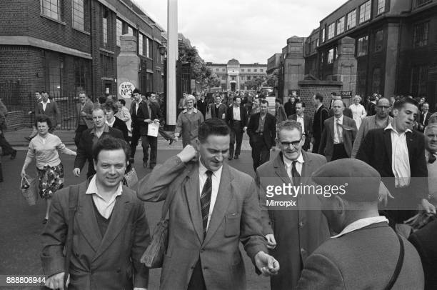 Workers pouring out of the GE Foundry in Electric Avenue Witton Birmingham Many stop at the newspaper vendor at the gates to buy a copy of the...