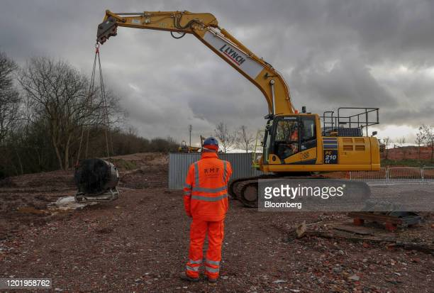 Workers practice maneuvering a piece of heavy equipment during Banksman center and Slinger training at the RMF Construction Ltd site in Birmingham UK...