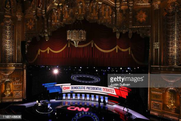 Workers prep the stage during a media briefing ahead of tonight's Democratic Presidential Debate at the Fox Theatre July 30, 2019 in Detroit,...