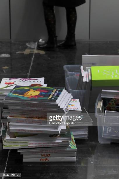 Workers prepare a display of books at an exhibitor's stand prior to the opening of the Frankfurt Book Fair on October 9, 2018 in Frankfurt, Germany....