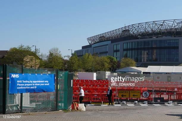 Workers prepare a drivethrough coronavirus testing centre for NHS staff at Twickenham stadium in southwest London on April 20 2020