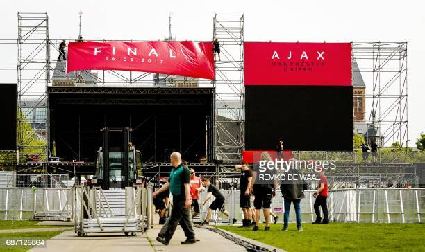 Workers prepare a fanzone on May 23 2017 on the Museumplein in Amsterdam on the eve of the Europa League finals match between Ajax and Manchester...
