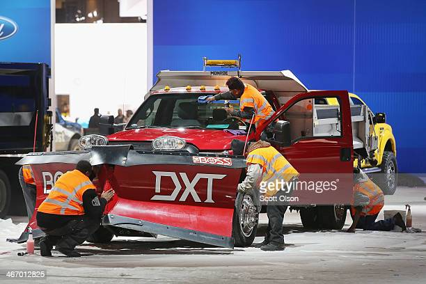 Workers prepare a Ford F550 truck for display at the Chicago Auto Show on February 5, 2014 in Chicago, Illinois. The show, which is held at McCormick...