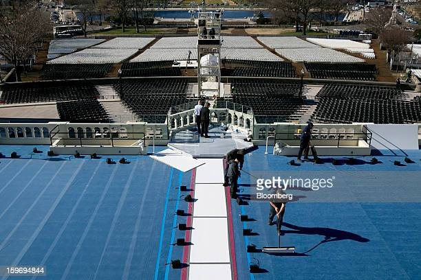 Workers prepare a platform outside the US Capitol prior to the second inauguration of US President Barack Obama in Washington DC US on Friday Jan 18...