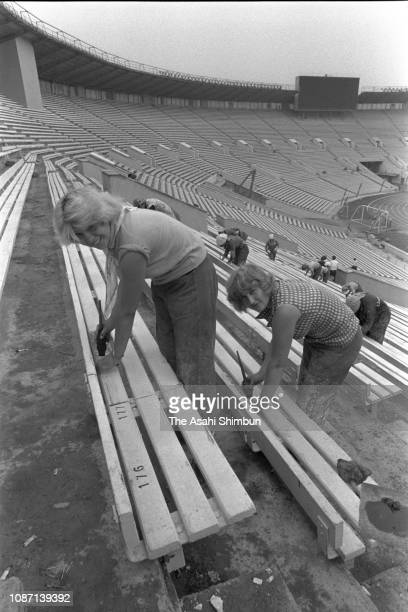 Workers prepare ahead of the PreOlympic Games event at the Lenin Stadium circa July 1979 in Moscow Soviet Union