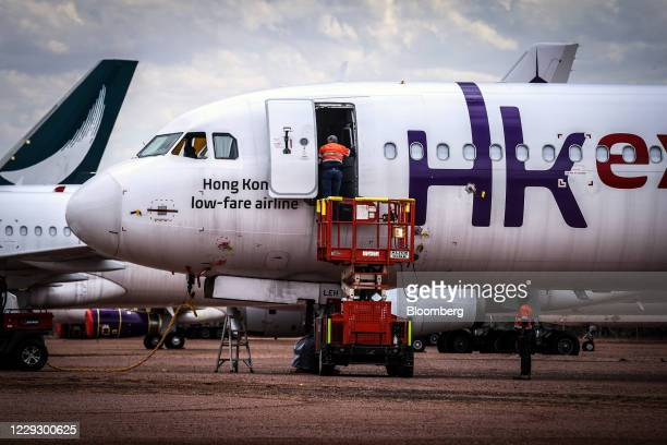 Workers prepare an aircraft during the induction process at the Asia Pacific Aircraft Storage Facility in Alice Springs, Northern Territory,...