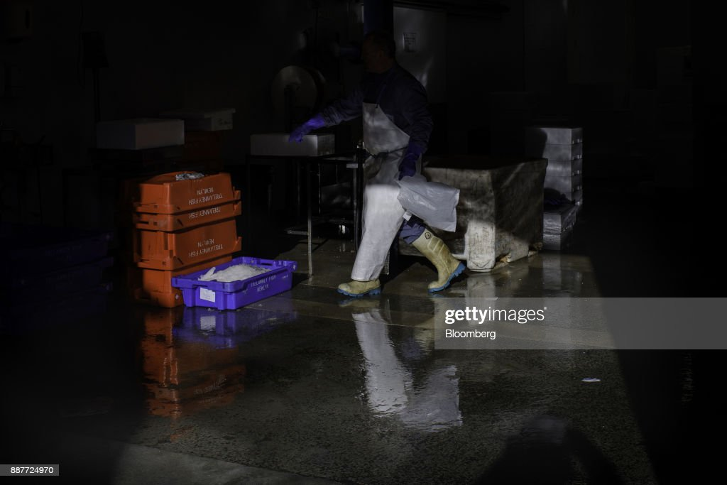 Workers prepare and pack fresh fish for export to Europe and shipment to the U.K. market at Trelawney Fish & Deli premises in Newlyn, U.K., on Tuesday, Nov. 28, 2017. Prime Minister Theresa May will pull Britain out of the 1964 London convention that allows European fishing vessels to access waters as close as six to twelve nautical miles from the U.K. coastline. Photographer: Annie Sakkab/Bloomberg via Getty Images