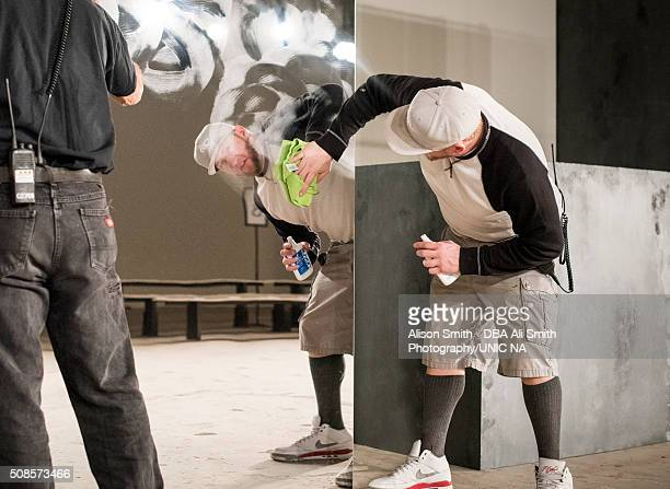 Workers prepare at the John Elliott + CO fashion show during New York Fashion Week Men's Fall/Winter 2016 at Skylight at Clarkson Sq on February 4,...