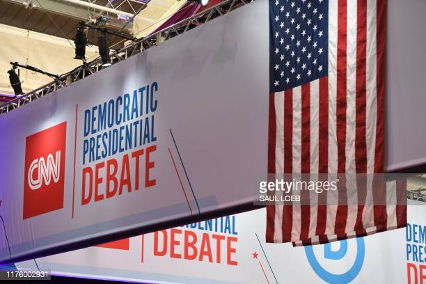 Workers prepare banners before the fourth Democratic primary debate of the 2020 presidential campaign season hosted by CNN and The New York Times at...