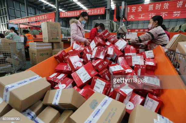 Workers prepare boxes for packaging goods for delivery at a sorting center in Lianyungang Jiangsu province during the Singles Day online shopping...