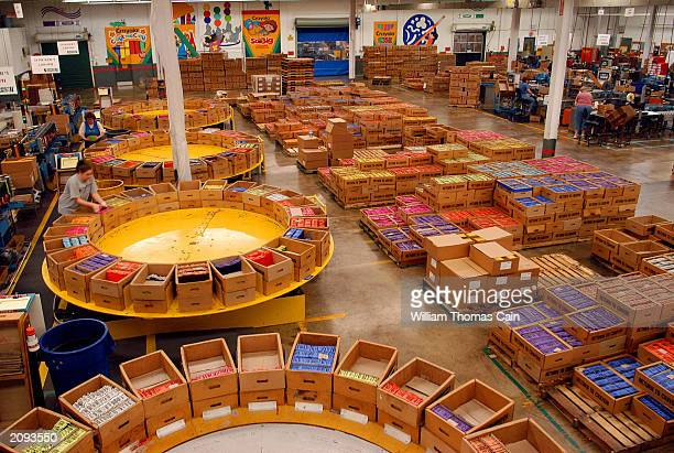 Workers prepare boxes of crayons for shipping at Binney and Smith Inc the manufacturer of Crayola crayons June 18 2003 in Easton Pennsylvania Binney...