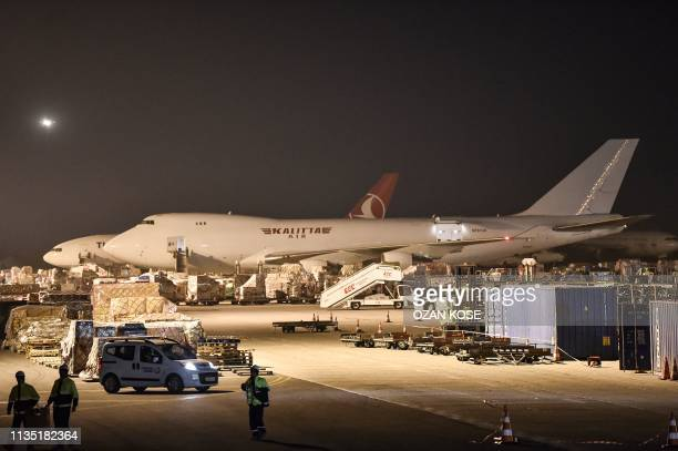 Workers prepare equipments to load to a cargo plane on the last day of flight operations of the Ataturk International airport late on April 5 2019 in...