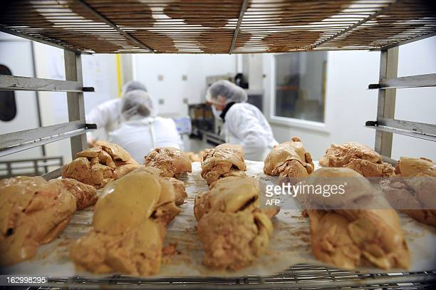 Workers prepare foie gras on February 28 on the process line of the laboratory Le hameau des saveurs in Cahors southwestern France AFP PHOTO/REMY...