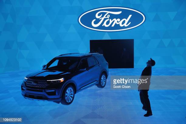 Workers prepare for a demonstration featuring the new 2020 Ford Explorer at the North American International Auto Show at the Cobo Center on January...