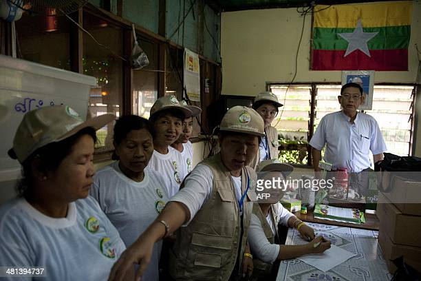 Workers prepare for the collection of census data in Yangon on March 30 2014 Myanmar is preparing its first census in decades giving a vital snapshot...