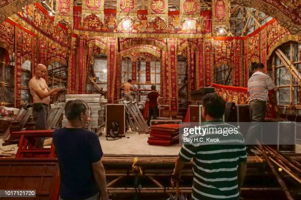 Workers prepare for the month of Hungry Ghost Festival on August 10 2018 in Hong Kong The Yu Lan Festival one of China's national intangible cultural...