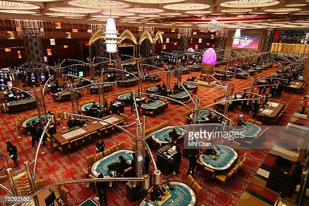 Workers prepare for the official opening ceremony and VIP reception, celebrating the opening of SJM's new flagship casino Grand Lisboa, on February...