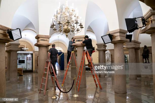 Workers prepare for the Presidential Inauguration at the U.S. Capitol on January 14, 2021 in Washington, DC. Security has been increased throughout...