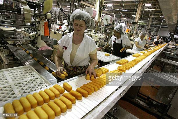 Workers prepare Hostess Twinkies for packaging at the Interstate Bakeries Corporation facility April 20 2005 in Schiller Park Illinois a suburb...