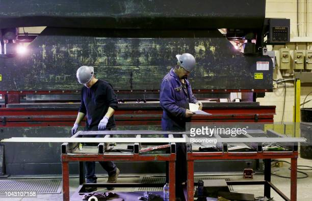Workers prepare materials at the Parr Metal Fabricators Ltd facility in Winnipeg Manitoba Canada on Wednesday Sept 19 2018 US and Canadian...