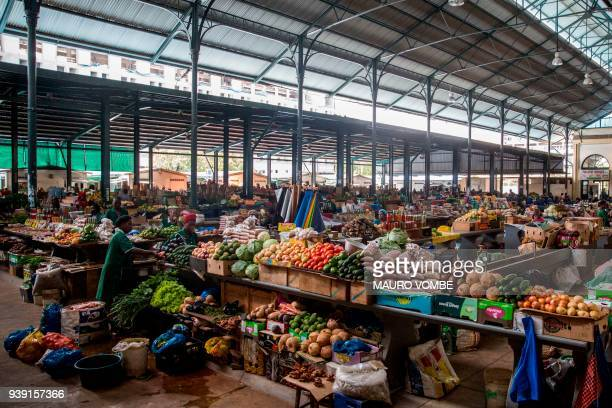 Workers prepare merchandise at the central market in Maputo on March 28 2018 Mozambique's renewed efforts to solve its spiralling secret debt crisis...