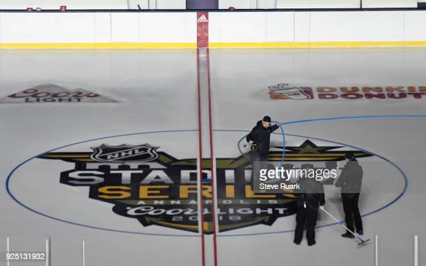 Workers prepare NavyMarine Corps Memorial Stadium for the 2018 Coors Light NHL Stadium Series game on February 27 2018 in Annapolis Maryland The game...