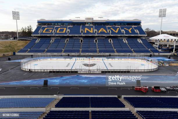 Workers prepare NavyMarine Corps Memorial Stadium for the 2018 Coors Light NHL Stadium Series game on February 28 2018 in Annapolis Maryland The game...